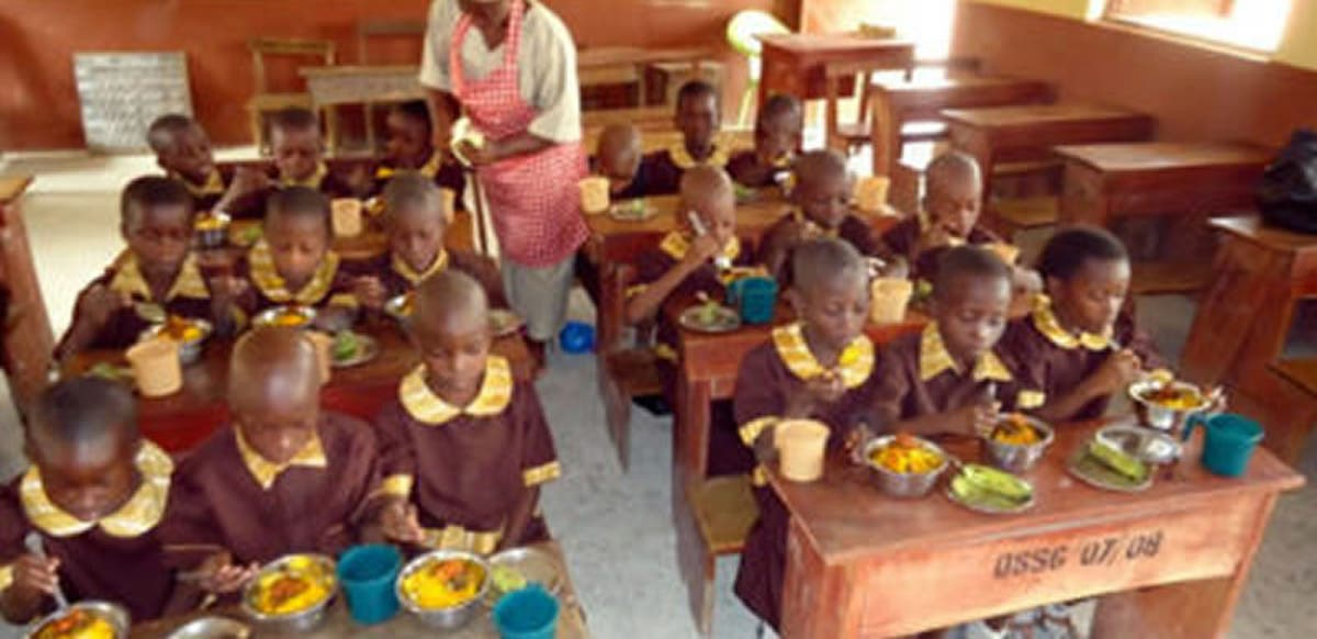 Primary school pupils having their meals. Photo: Punch