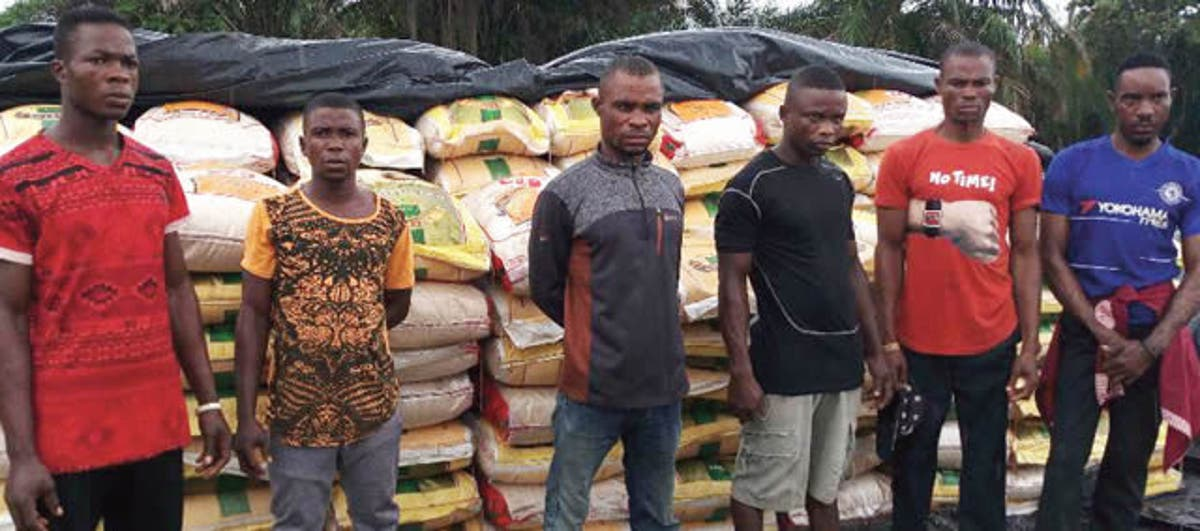Image result for Navy hands over contraband rice, suspects to Customs